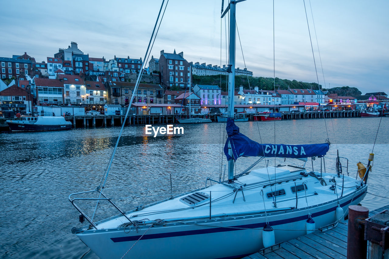 nautical vessel, mode of transportation, transportation, water, building exterior, architecture, sky, built structure, nature, moored, cloud - sky, day, harbor, city, sea, sailboat, mast, real people, outdoors, yacht