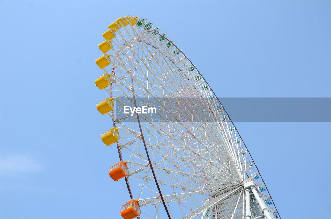 Low Angle View Of Ferris Wheel Against The Sky