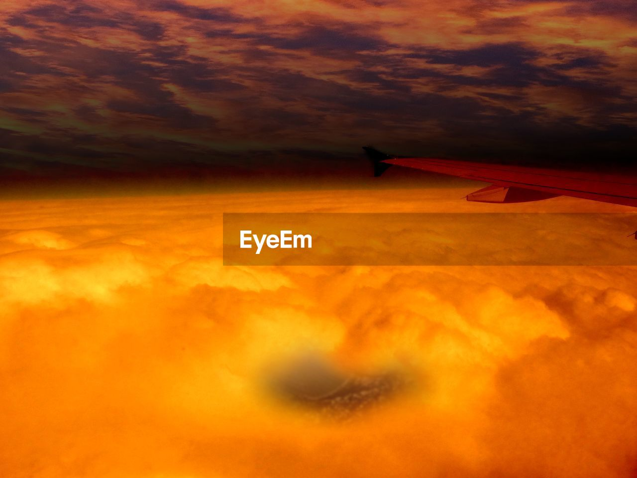 sunset, airplane, transportation, cloud - sky, orange color, sky, air vehicle, mode of transport, nature, journey, flying, airplane wing, scenics, no people, beauty in nature, outdoors, aircraft wing, day