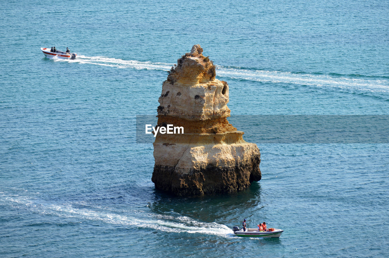 HIGH ANGLE VIEW OF NAUTICAL VESSEL ON SEA