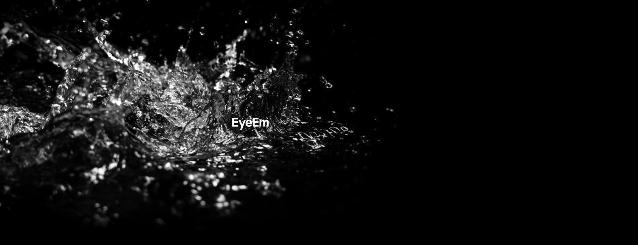 night, no people, copy space, water, close-up, nature, illuminated, outdoors, dark, splashing, selective focus, motion, tree, reflection, black background, studio shot, waterfront, lighting equipment
