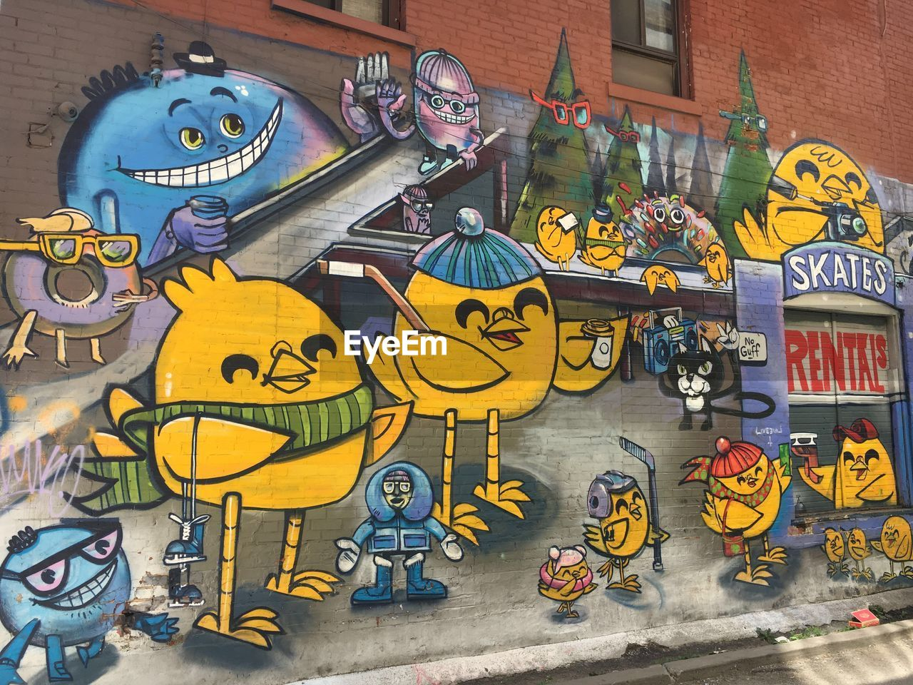 representation, art and craft, architecture, human representation, no people, creativity, multi colored, male likeness, built structure, graffiti, building exterior, female likeness, text, day, variation, city, communication, yellow, choice, mural