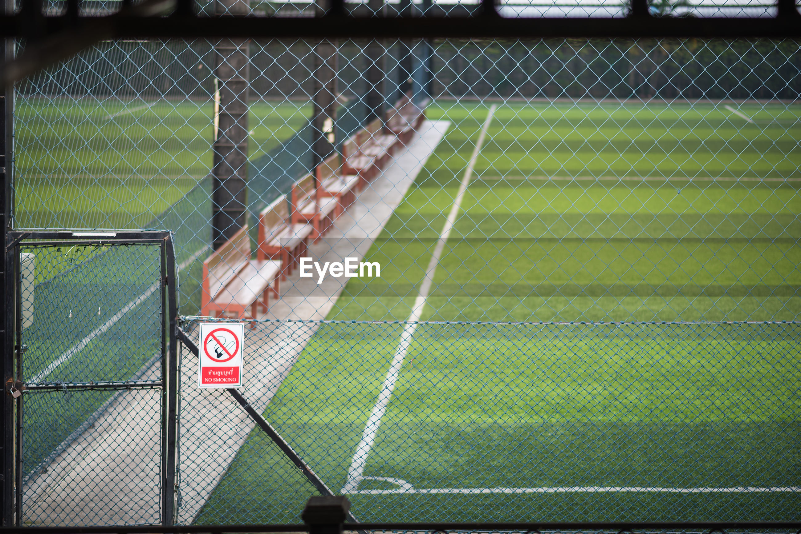 Full frame shot chainlink fence on playing field