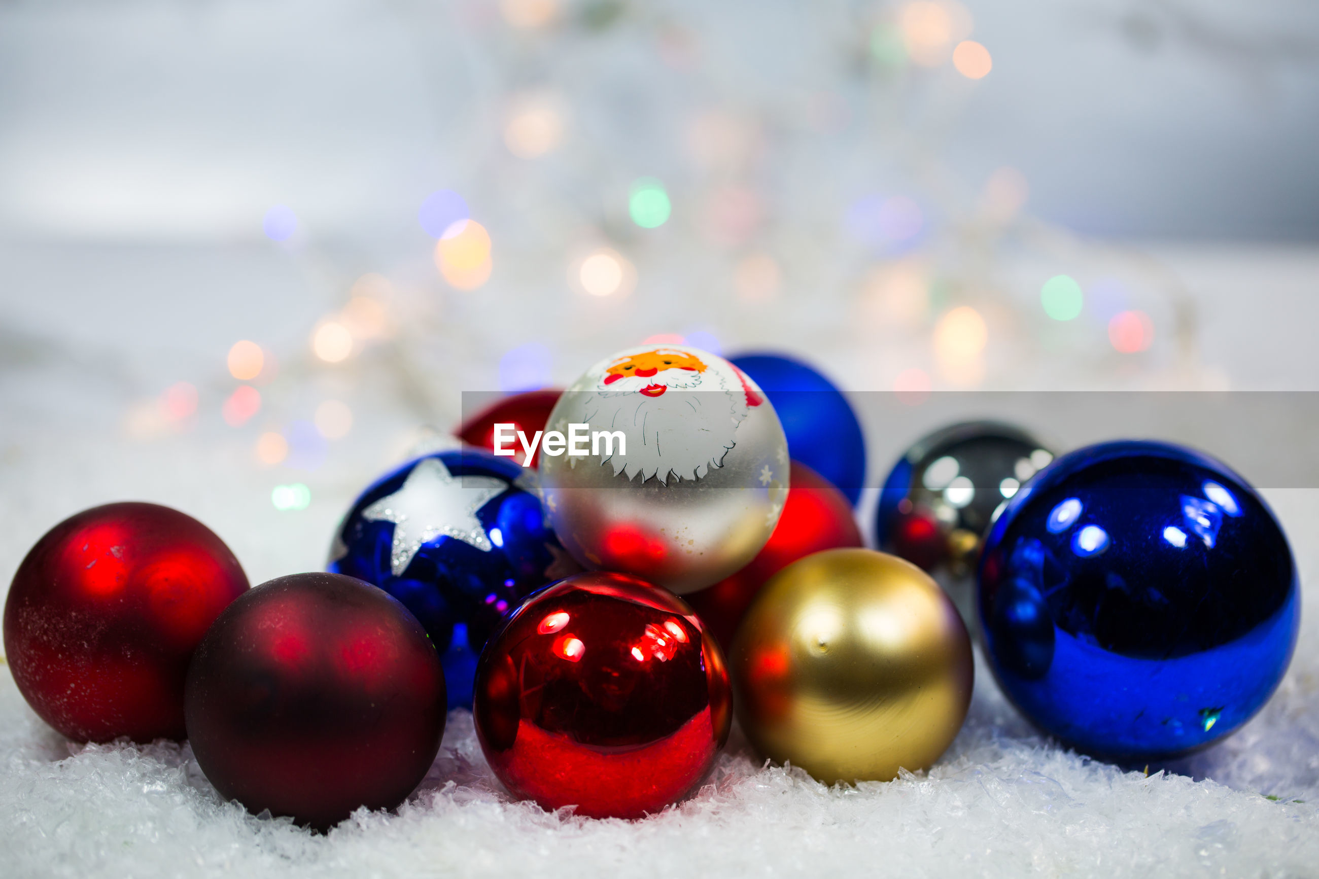 multi colored, celebration, sphere, close-up, no people, holiday, snow, winter, ball, shiny, cold temperature, selective focus, christmas, indoors, focus on foreground, still life, decoration, shape, christmas ornament