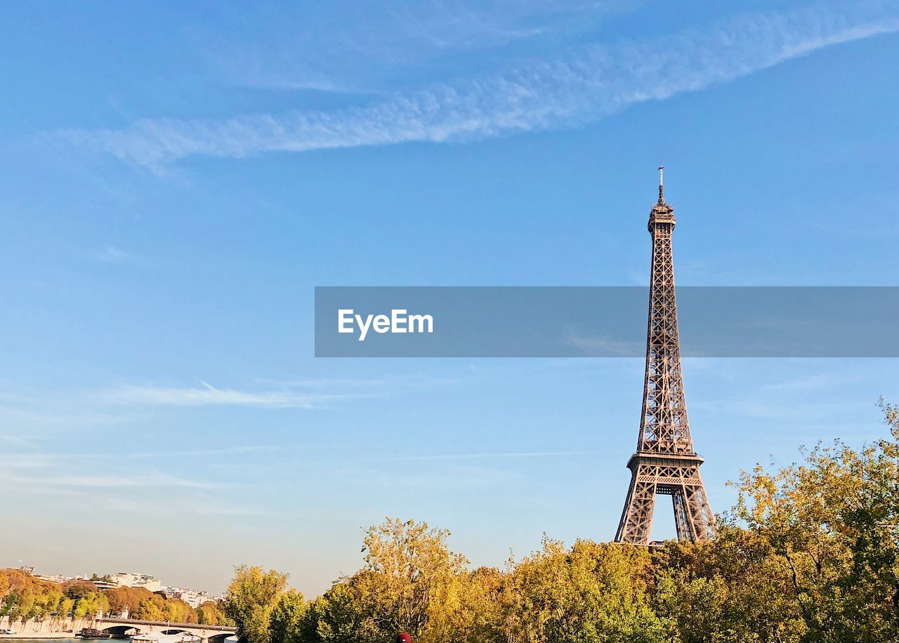 View of eiffel tower against blue sky