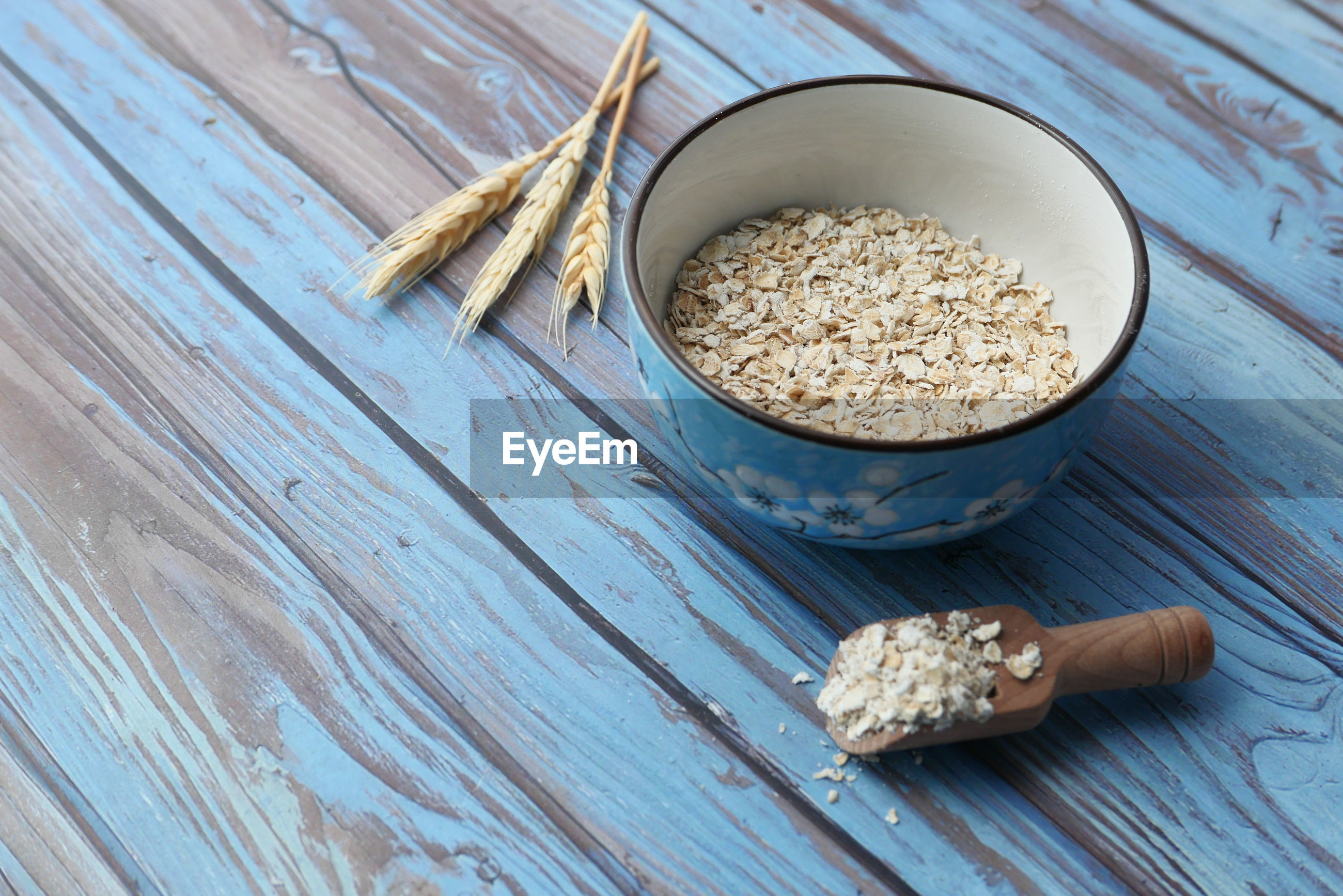 High angle view of oats flakes on in a bowl on table.