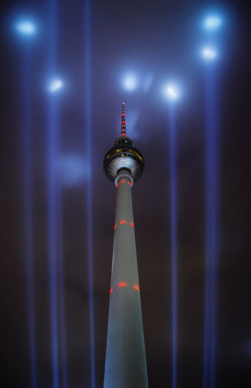 Low Angle View Of Illuminated Communications Tower At Night