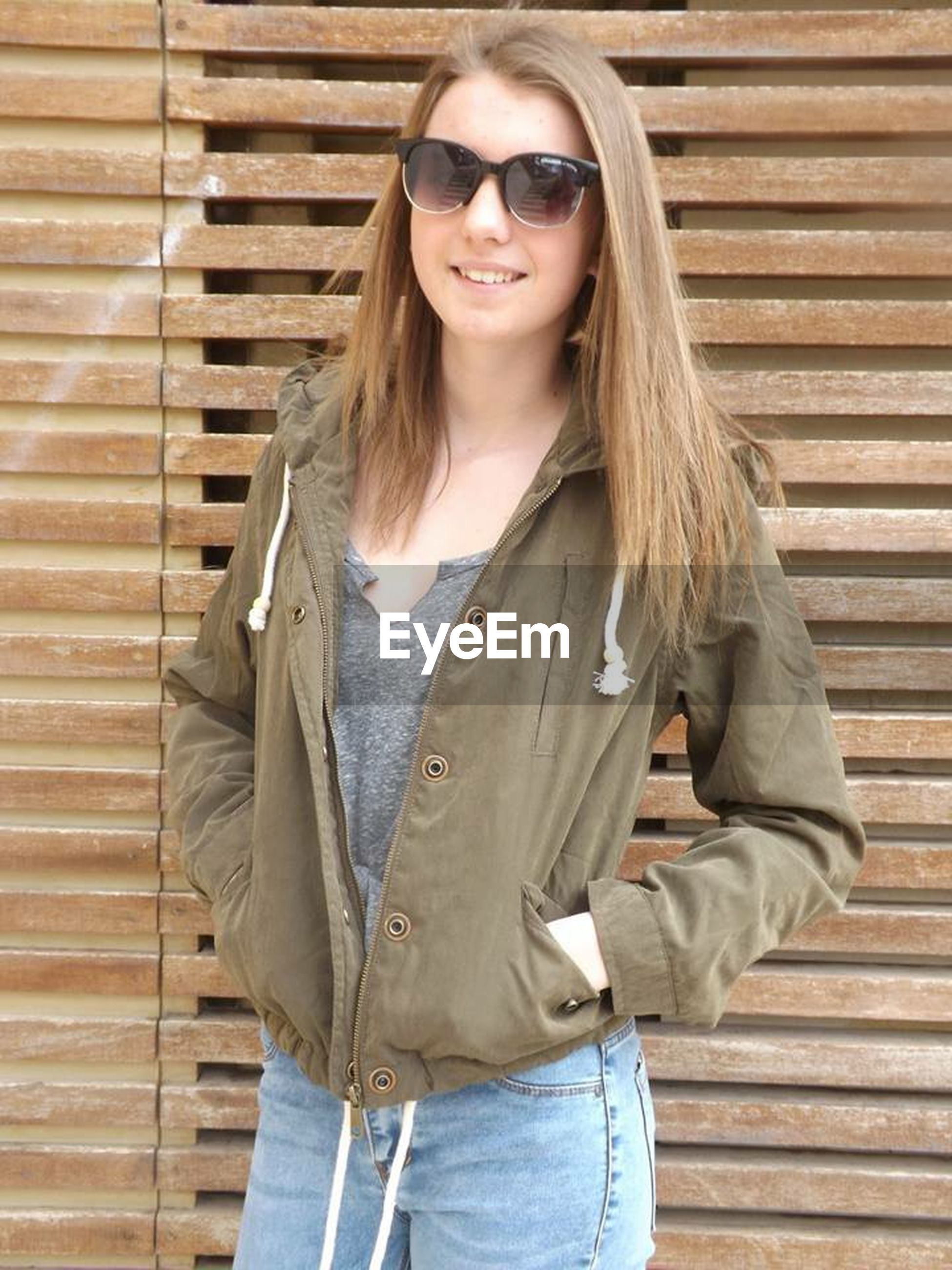 young adult, casual clothing, person, young women, lifestyles, front view, standing, portrait, looking at camera, long hair, three quarter length, leisure activity, waist up, sunglasses, jacket, fashionable