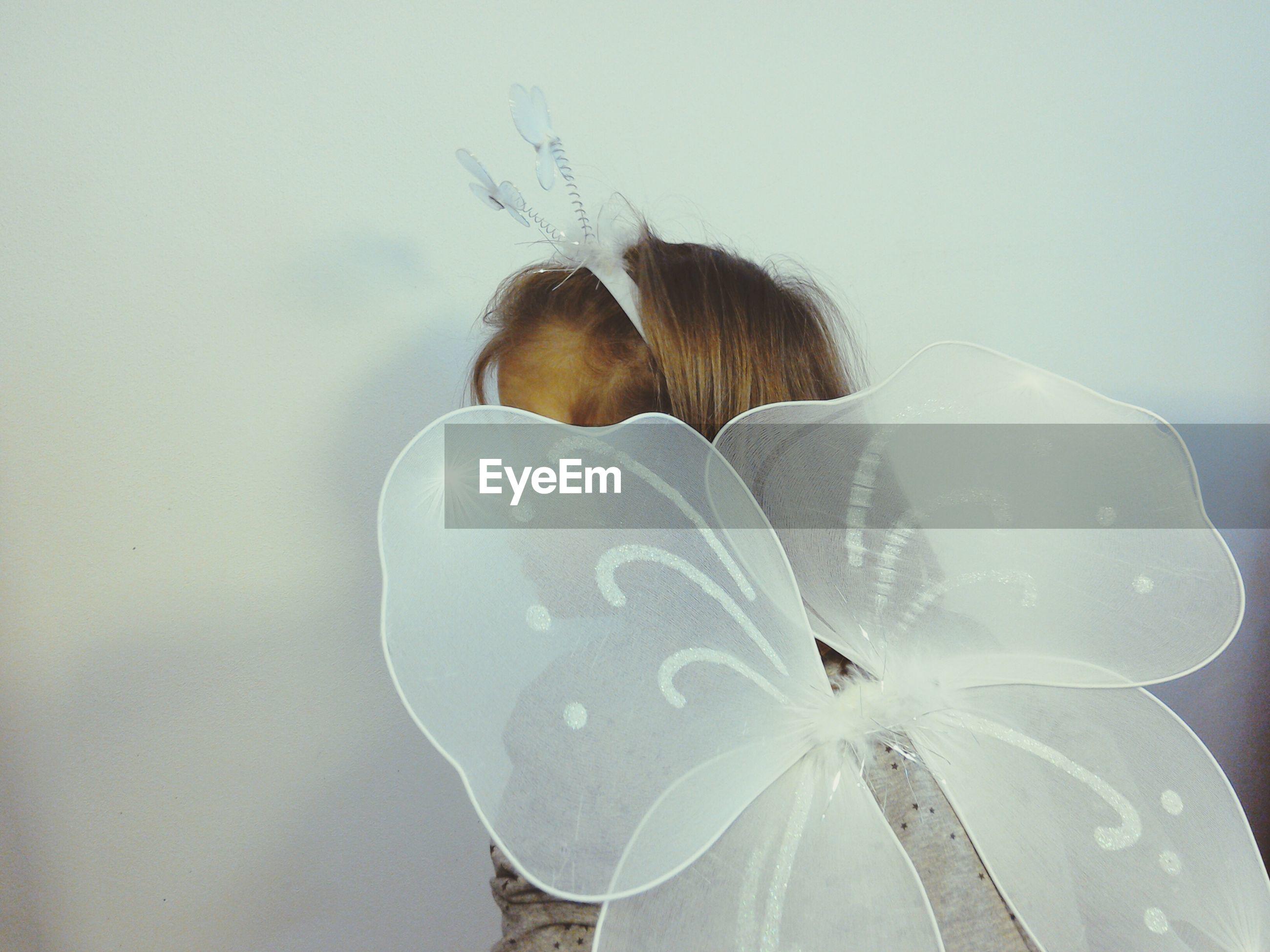 Girl wearing butterfly costume