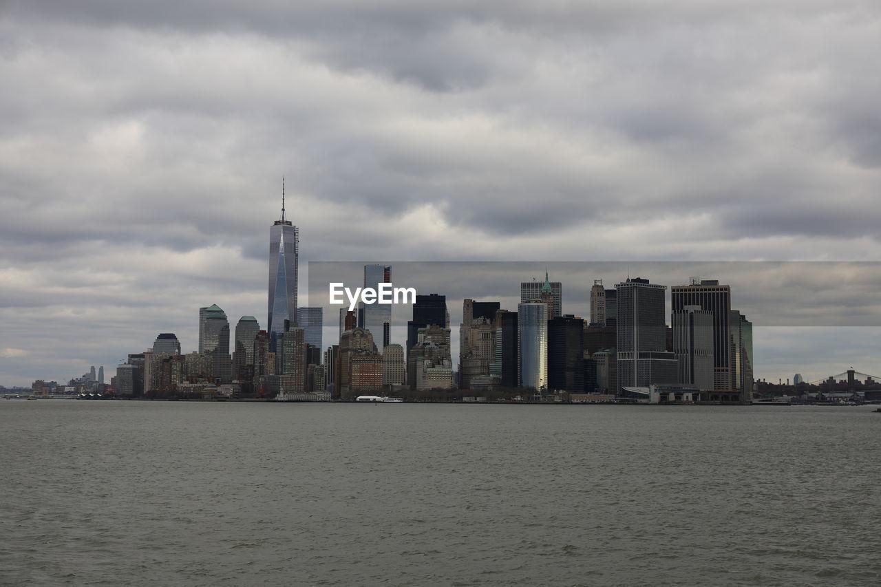 MODERN BUILDINGS AGAINST CLOUDY SKY