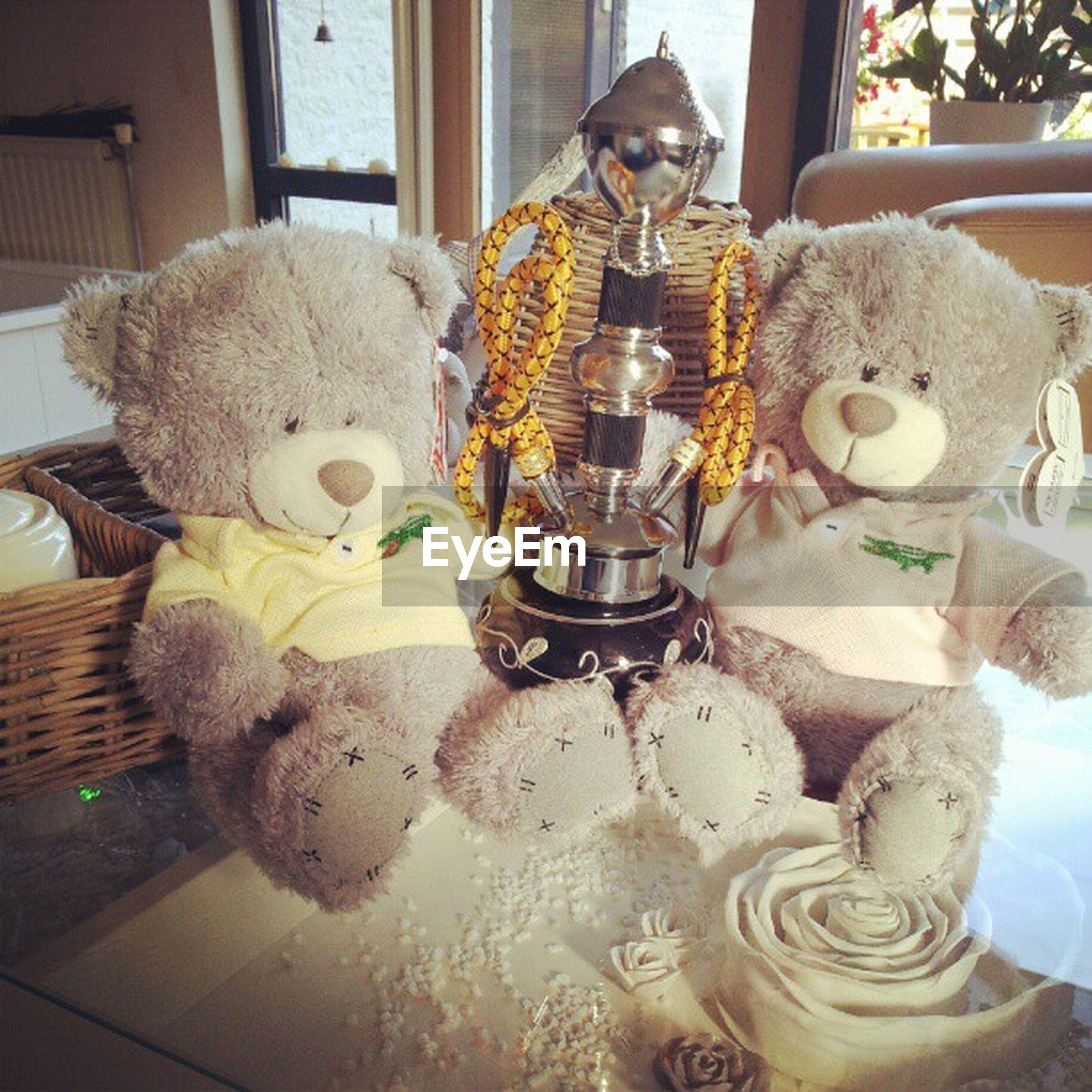 indoors, home interior, animal representation, toy, human representation, stuffed toy, art and craft, art, table, still life, decoration, creativity, teddy bear, figurine, no people, statue, sculpture, christmas