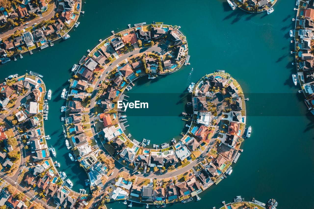 water, nature, architecture, high angle view, built structure, circle, sea, geometric shape, day, building exterior, no people, outdoors, shape, leisure activity, directly above, amusement park, aerial view, arts culture and entertainment, directly below