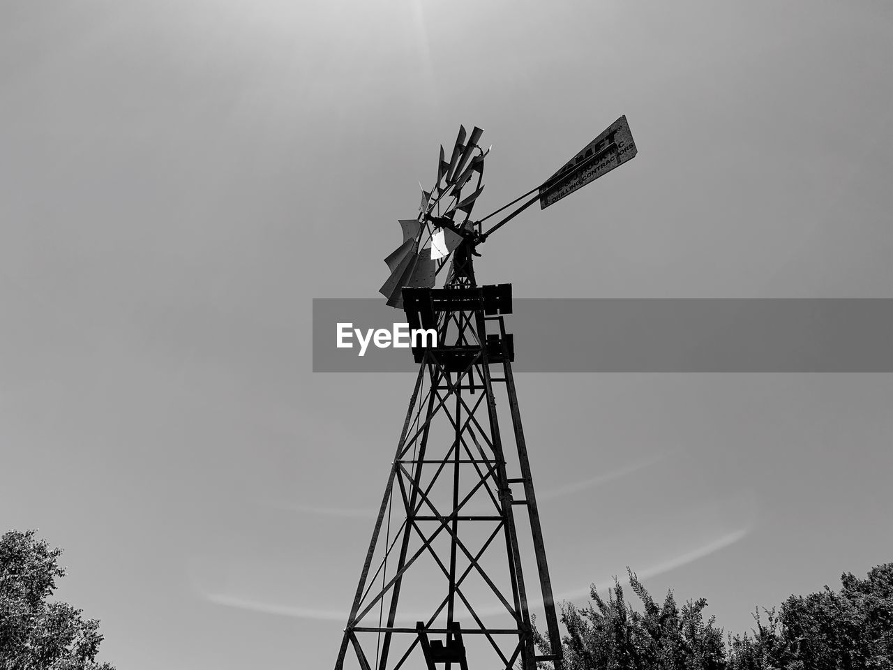 sky, renewable energy, low angle view, wind turbine, wind power, nature, turbine, alternative energy, fuel and power generation, environmental conservation, tree, traditional windmill, day, plant, architecture, no people, environment, outdoors, built structure, industry