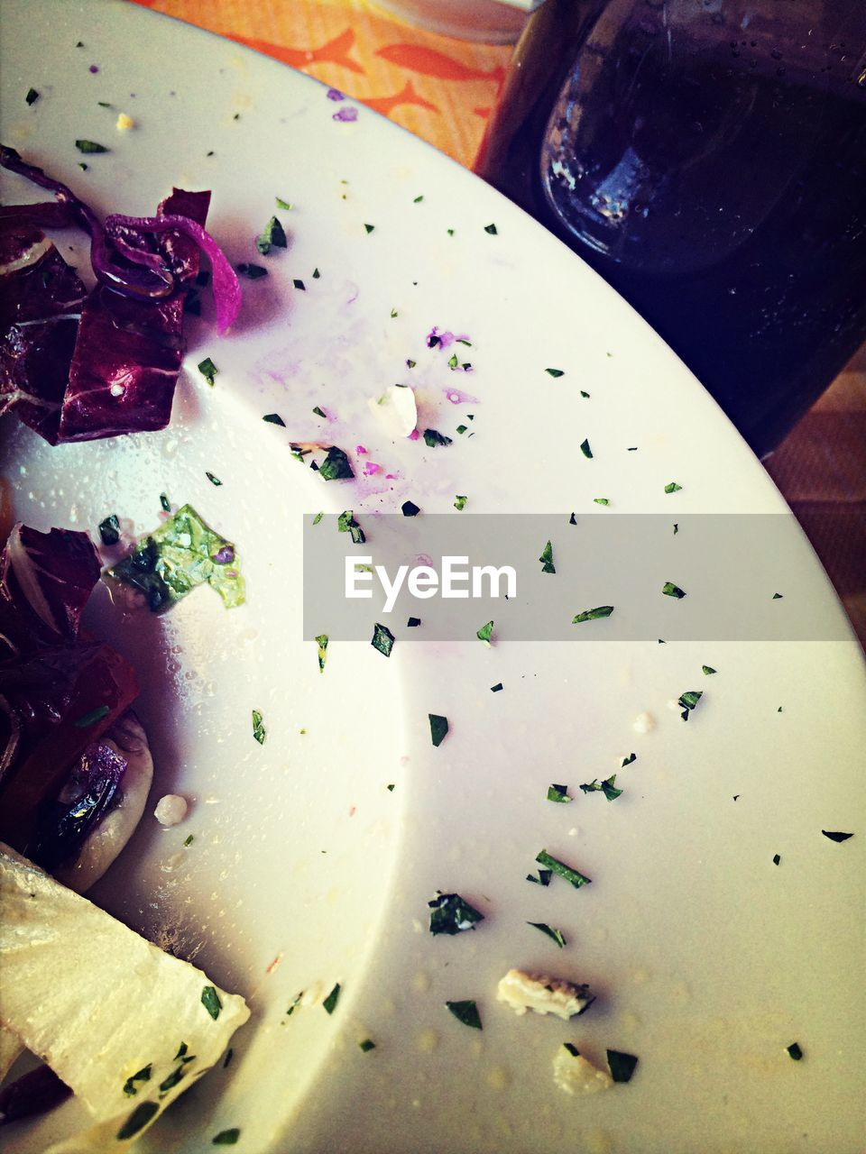 Cropped image of salad in plate on table