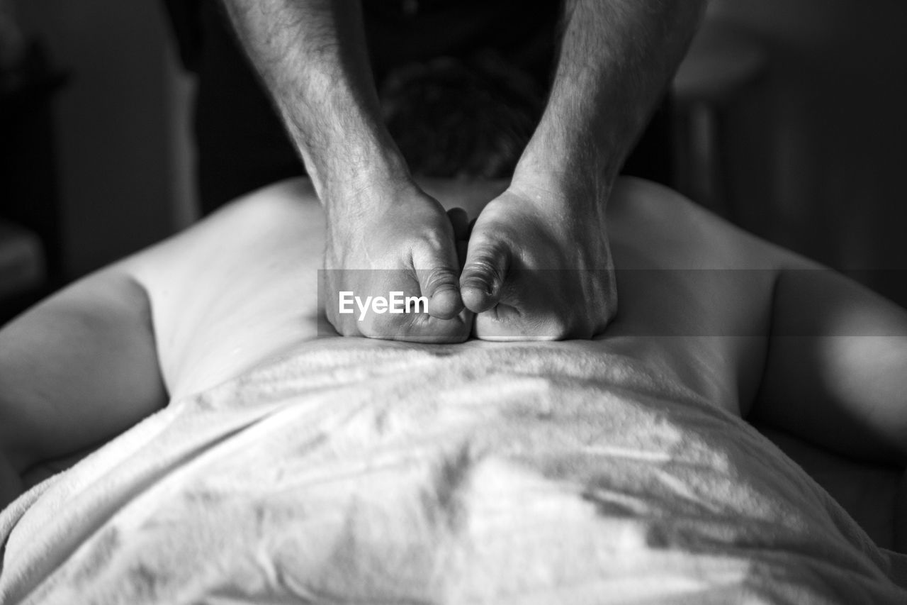 Cropped Image Of Therapist Massing Patient Back At Spa