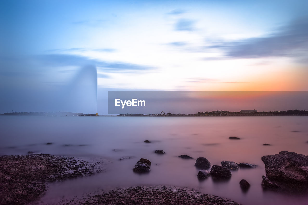 sky, sunset, rock, solid, rock - object, beauty in nature, cloud - sky, scenics - nature, water, tranquil scene, sea, tranquility, no people, nature, idyllic, long exposure, land, outdoors, beach