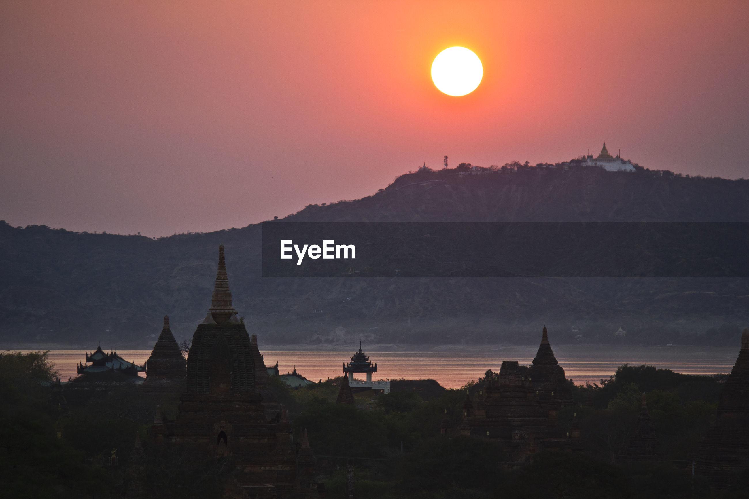 Sunset through temples in bagan, myanmar
