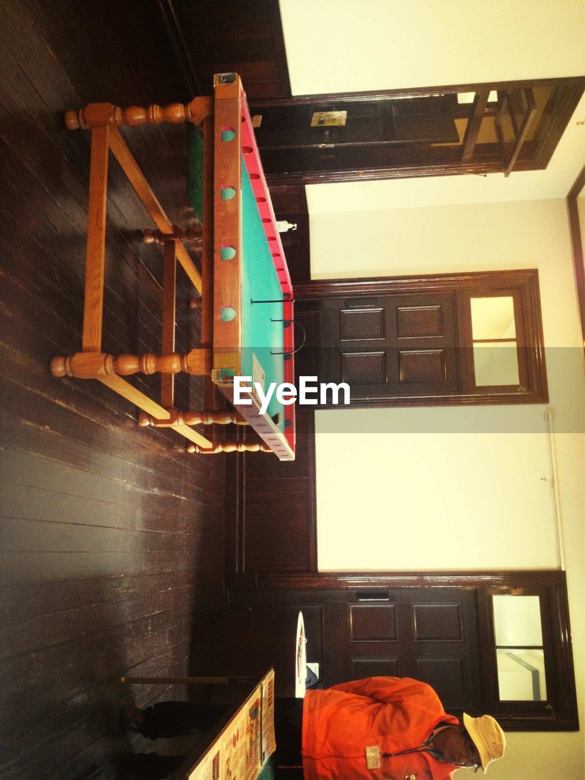 architecture, built structure, building exterior, window, indoors, house, residential building, balcony, low angle view, residential structure, railing, steps, staircase, building, steps and staircases, day, sunlight, clothing, drying, laundry