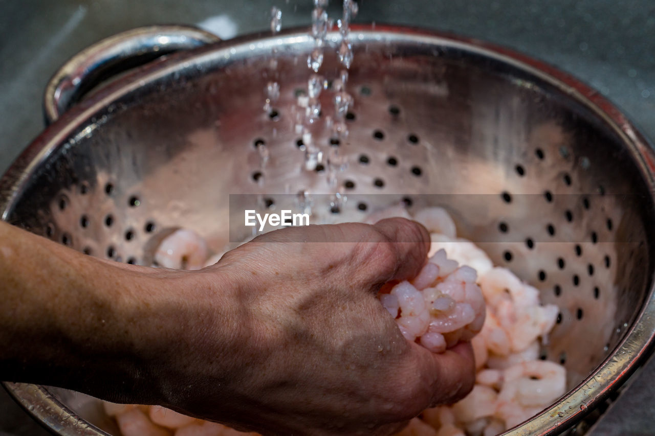 Cropped hand washing shrimps
