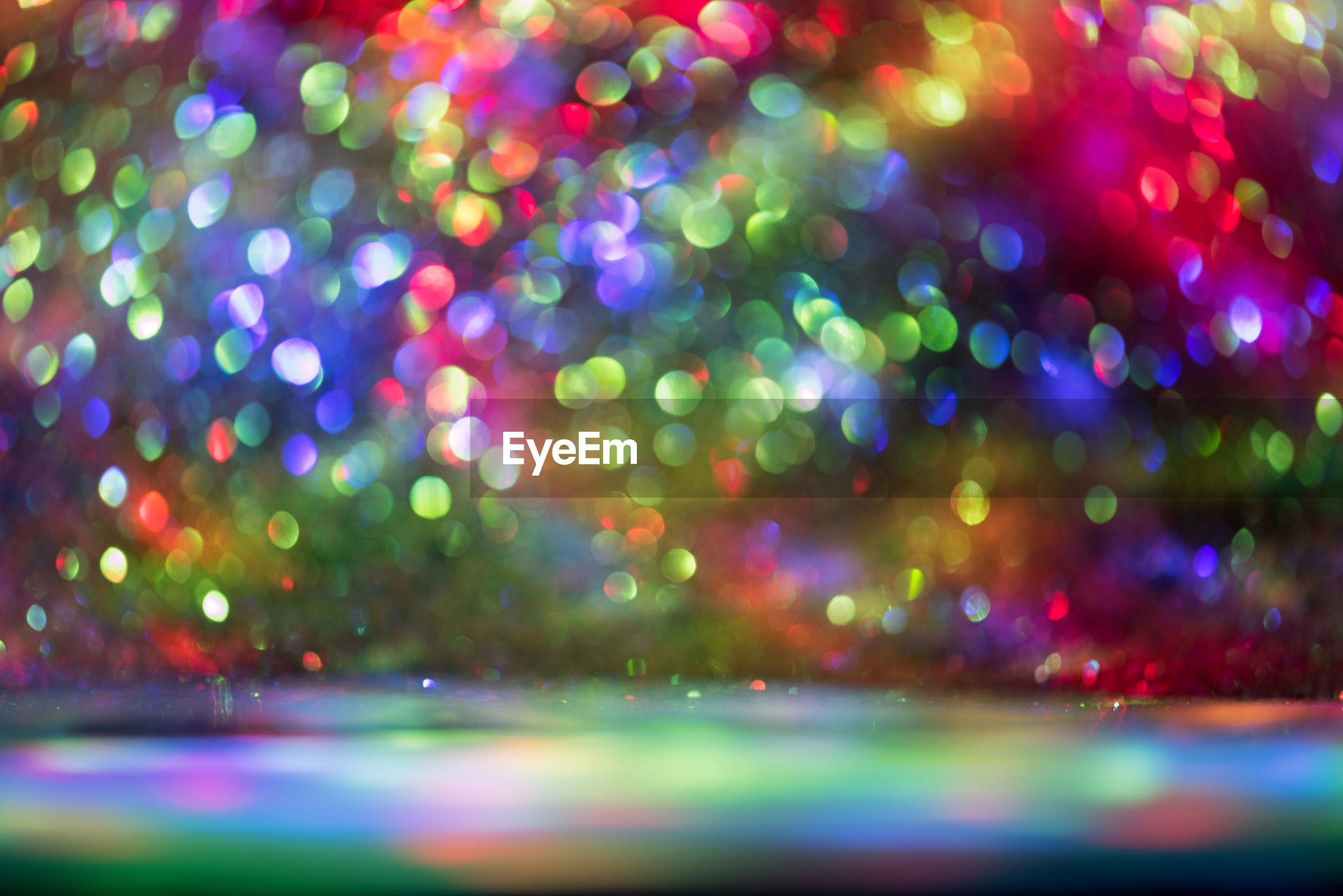 Defocused image of multi colored glitters