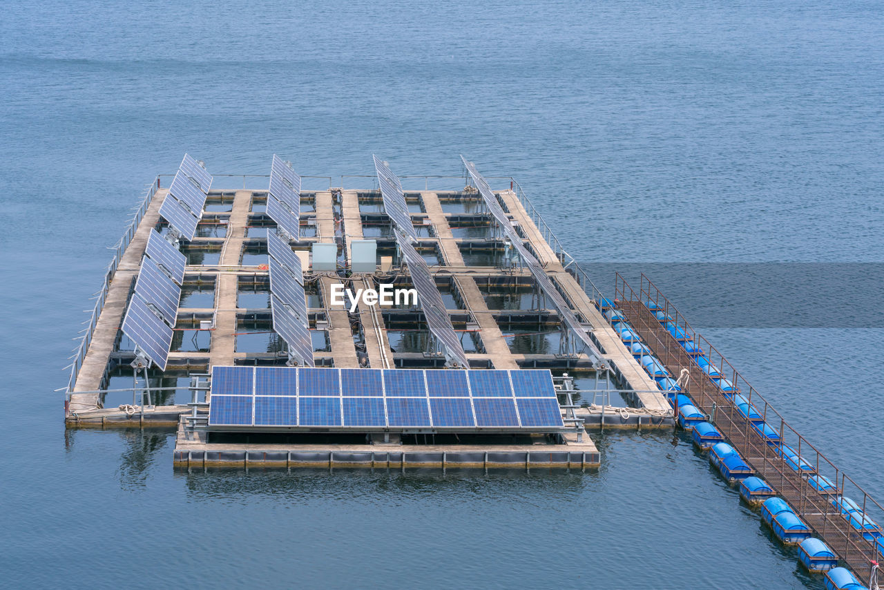 High Angle View Of Solar Panels In Sea