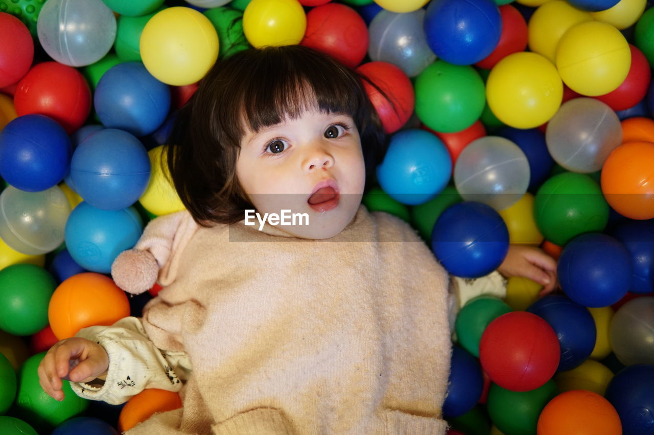 Portrait of cute baby girl in ball pool