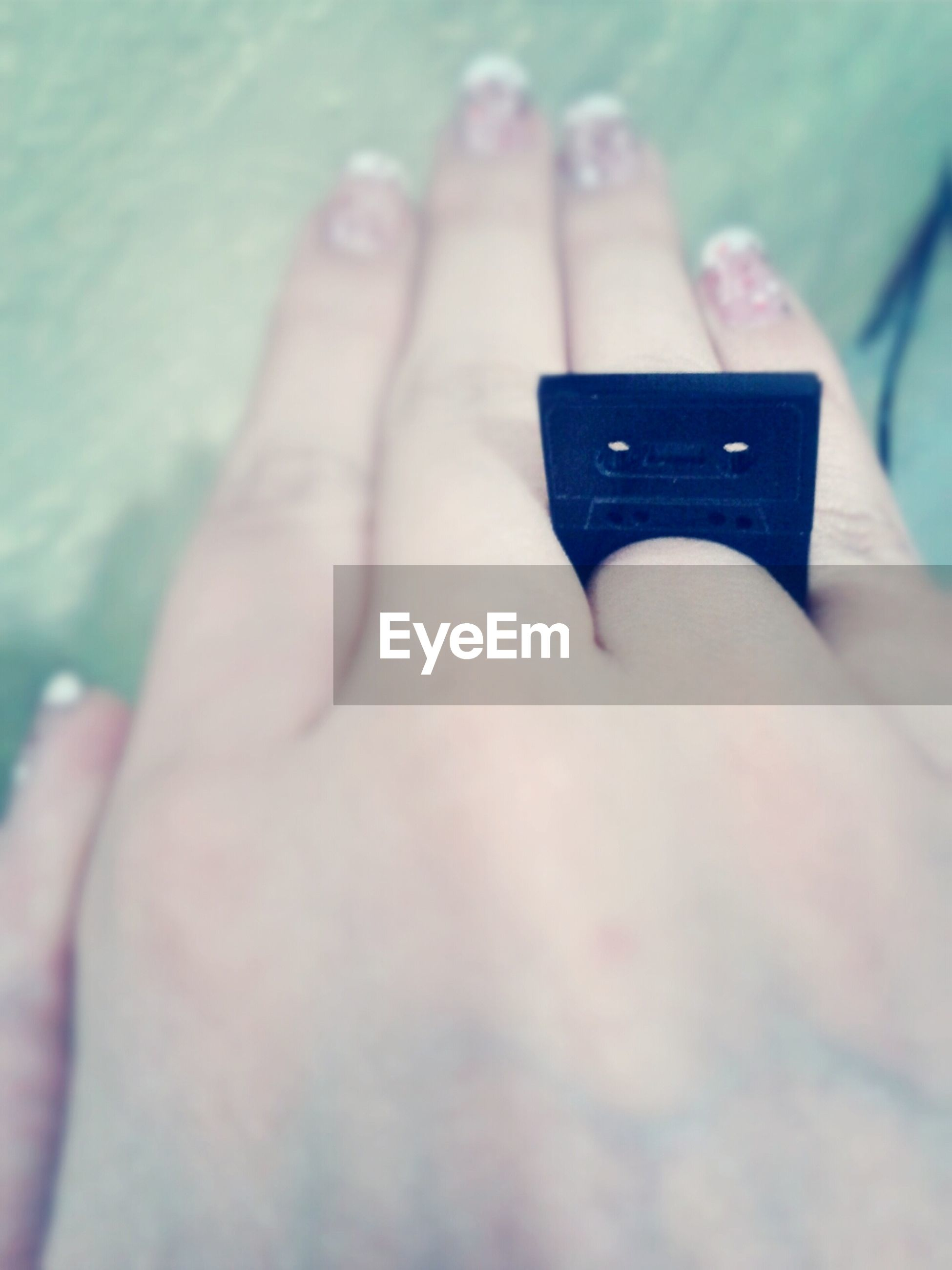 person, part of, human finger, cropped, holding, lifestyles, close-up, indoors, personal perspective, nail polish, leisure activity, unrecognizable person, selective focus, focus on foreground, showing