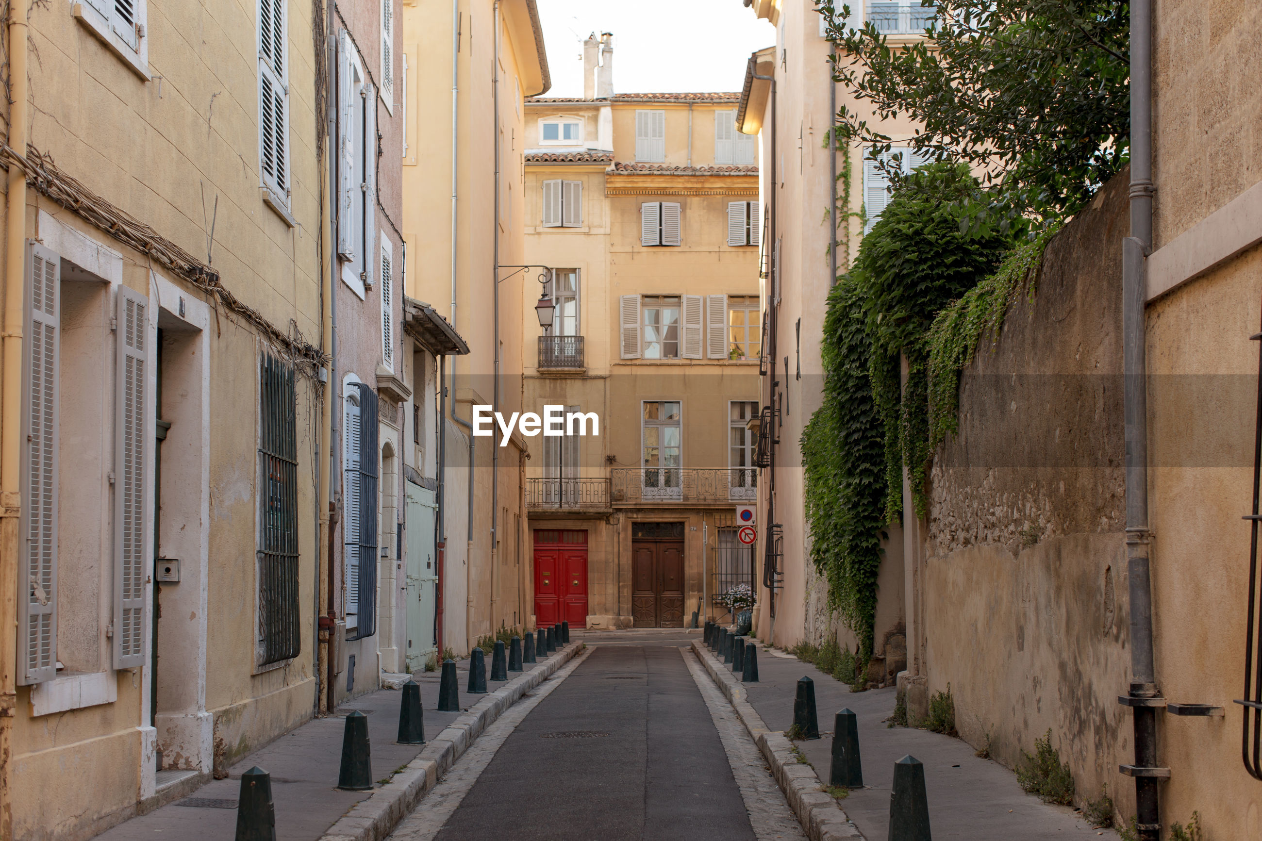 Old buildings along narrow alley in france