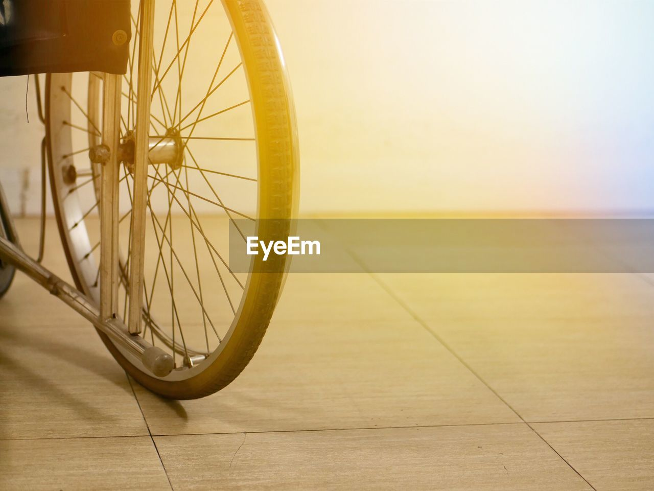 bicycle, wheel, land vehicle, transportation, no people, spoke, mode of transportation, stationary, focus on foreground, indoors, close-up, tire, wood - material, flooring, day, travel, wall - building feature, tiled floor, wood