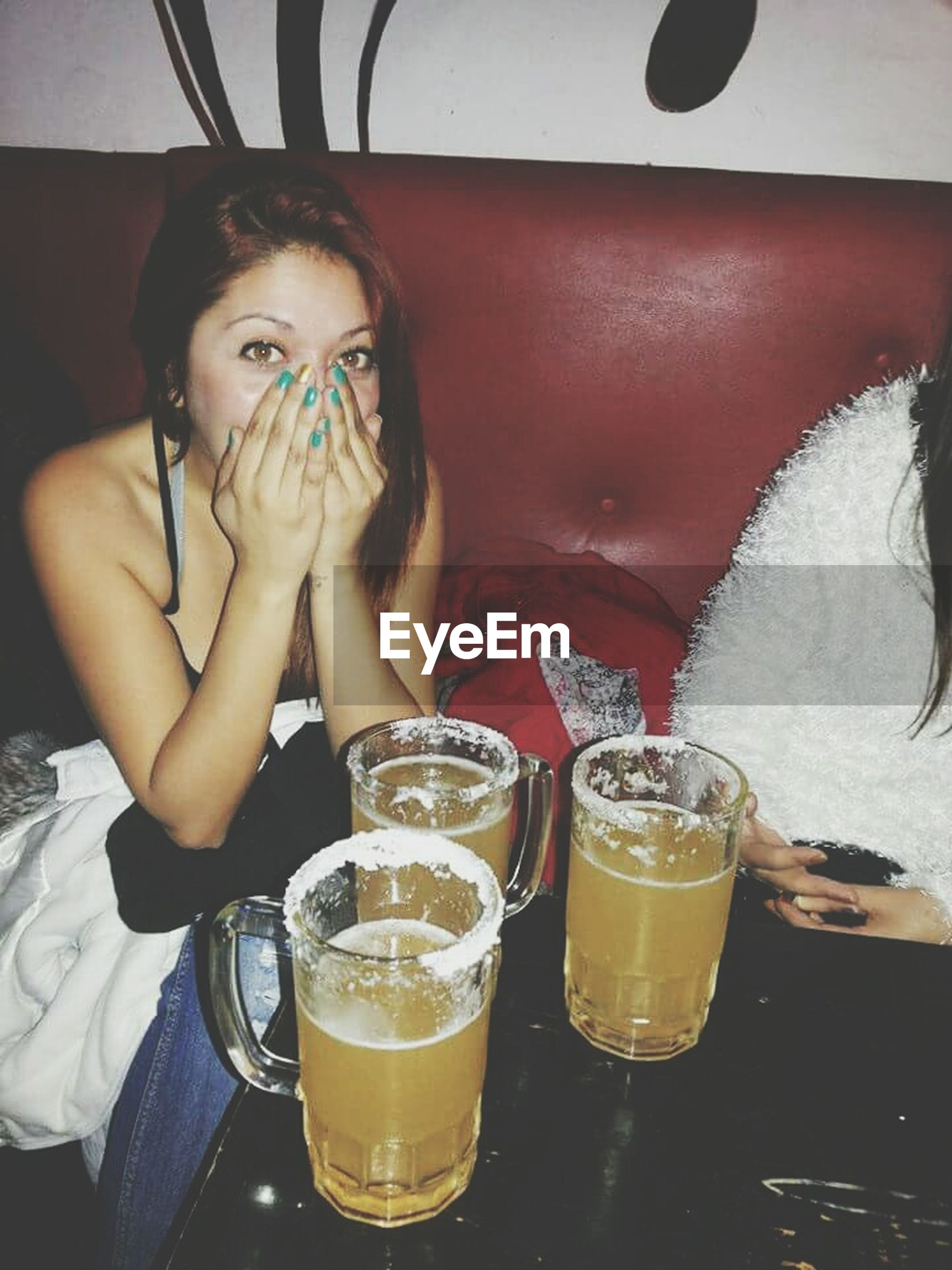 drink, food and drink, real people, refreshment, drinking glass, drinking, one person, alcohol, sitting, table, frothy drink, indoors, leisure activity, drinking straw, lifestyles, eyeglasses, young women, freshness, young adult, day, human hand, people