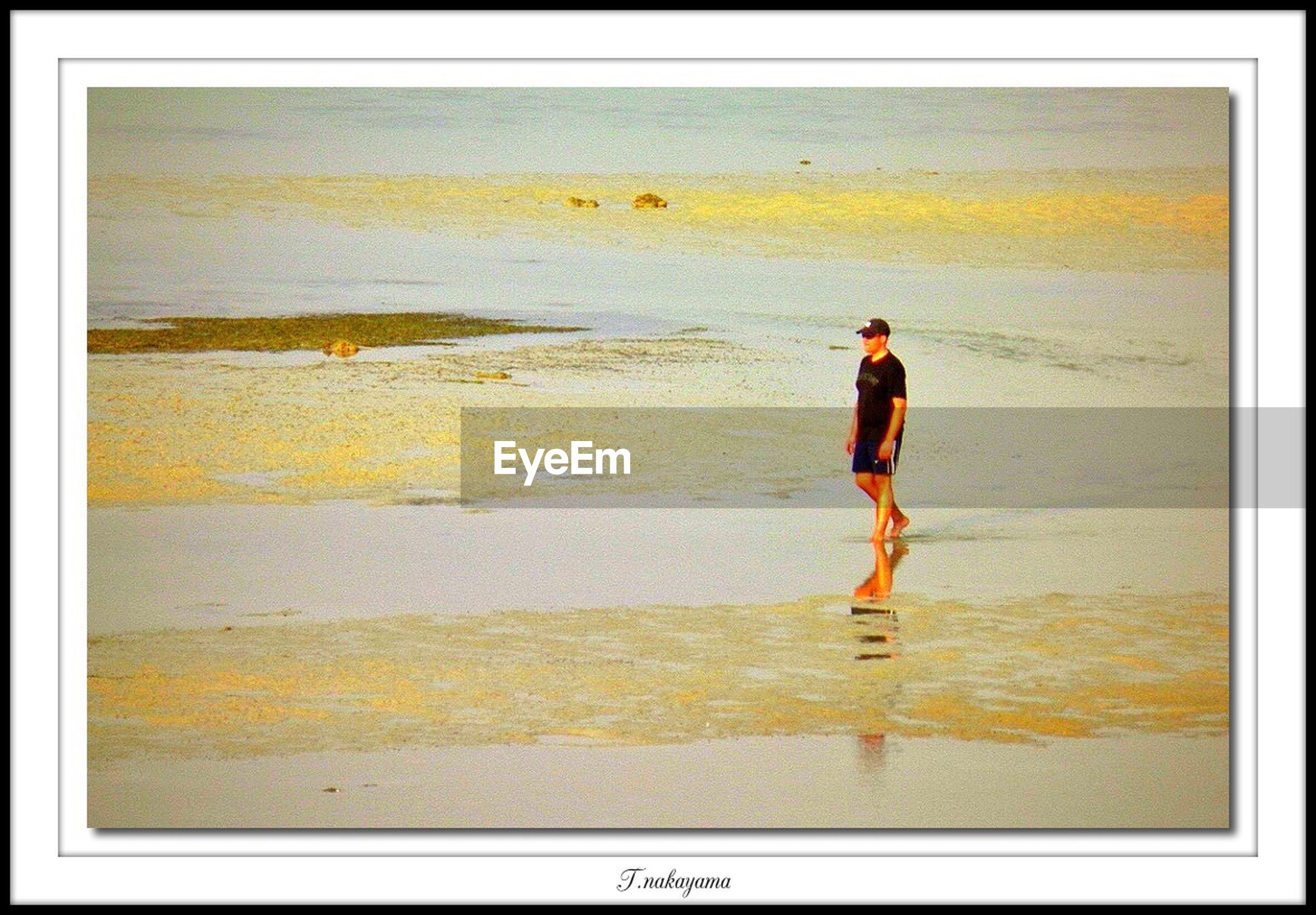 water, transfer print, lifestyles, full length, auto post production filter, leisure activity, standing, rear view, sea, casual clothing, beach, men, walking, shore, person, outdoors, reflection, horizon over water