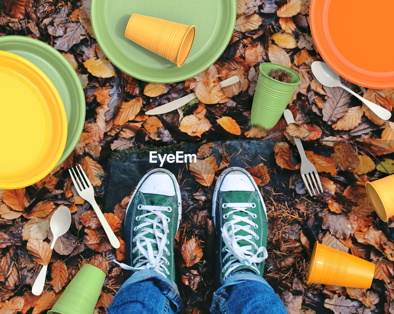 low section, shoe, human body part, high angle view, human leg, body part, personal perspective, one person, real people, directly above, lifestyles, men, leaf, plant part, standing, nature, autumn, land, human foot, leaves, jeans