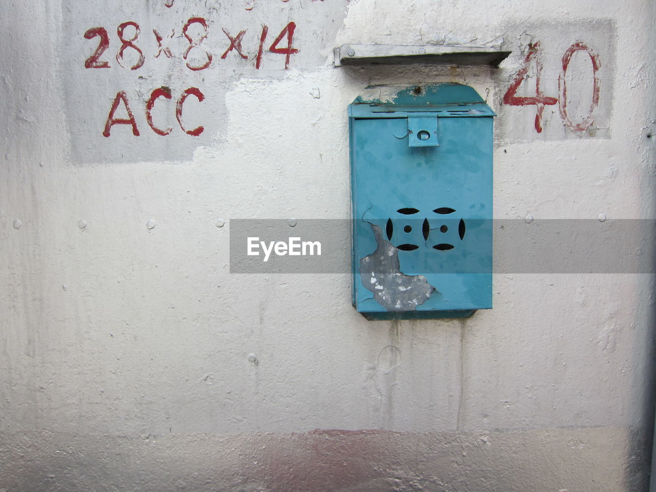 communication, wall - building feature, no people, text, built structure, sign, western script, architecture, day, safety, close-up, security, wall, building exterior, door, number, outdoors, blue, information, electricity, power supply
