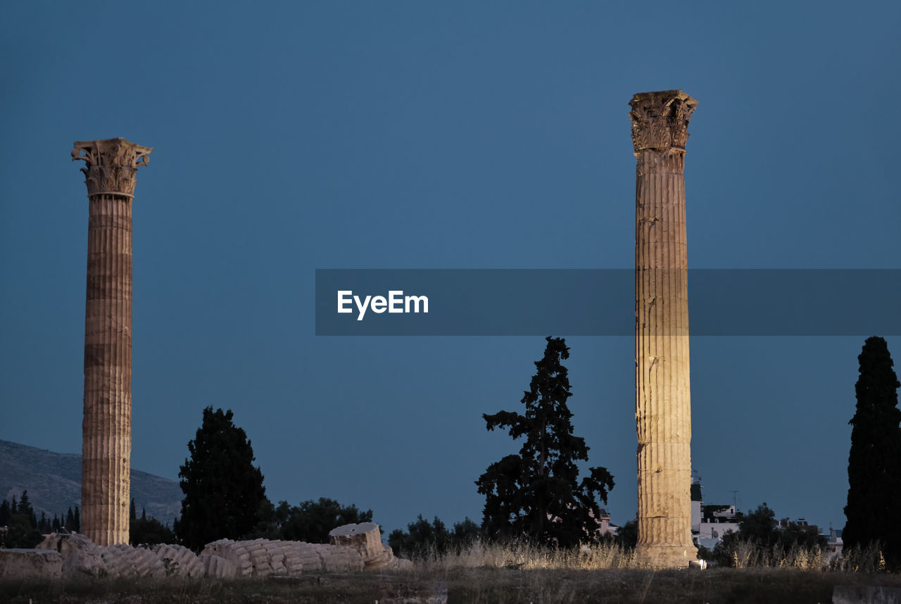sky, architectural column, architecture, built structure, nature, no people, the past, history, clear sky, blue, ancient, old ruin, tree, plant, travel destinations, ancient civilization, day, damaged, low angle view, travel, outdoors, ruined, archaeology