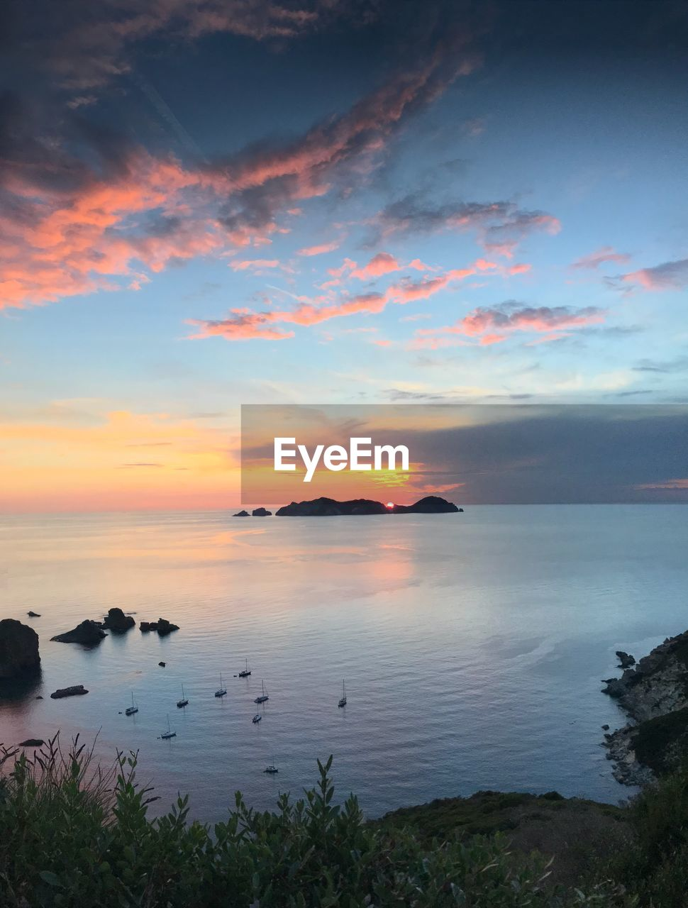 sky, sunset, beauty in nature, water, scenics - nature, cloud - sky, tranquility, tranquil scene, sea, idyllic, no people, nature, orange color, rock, reflection, horizon, non-urban scene, horizon over water, outdoors