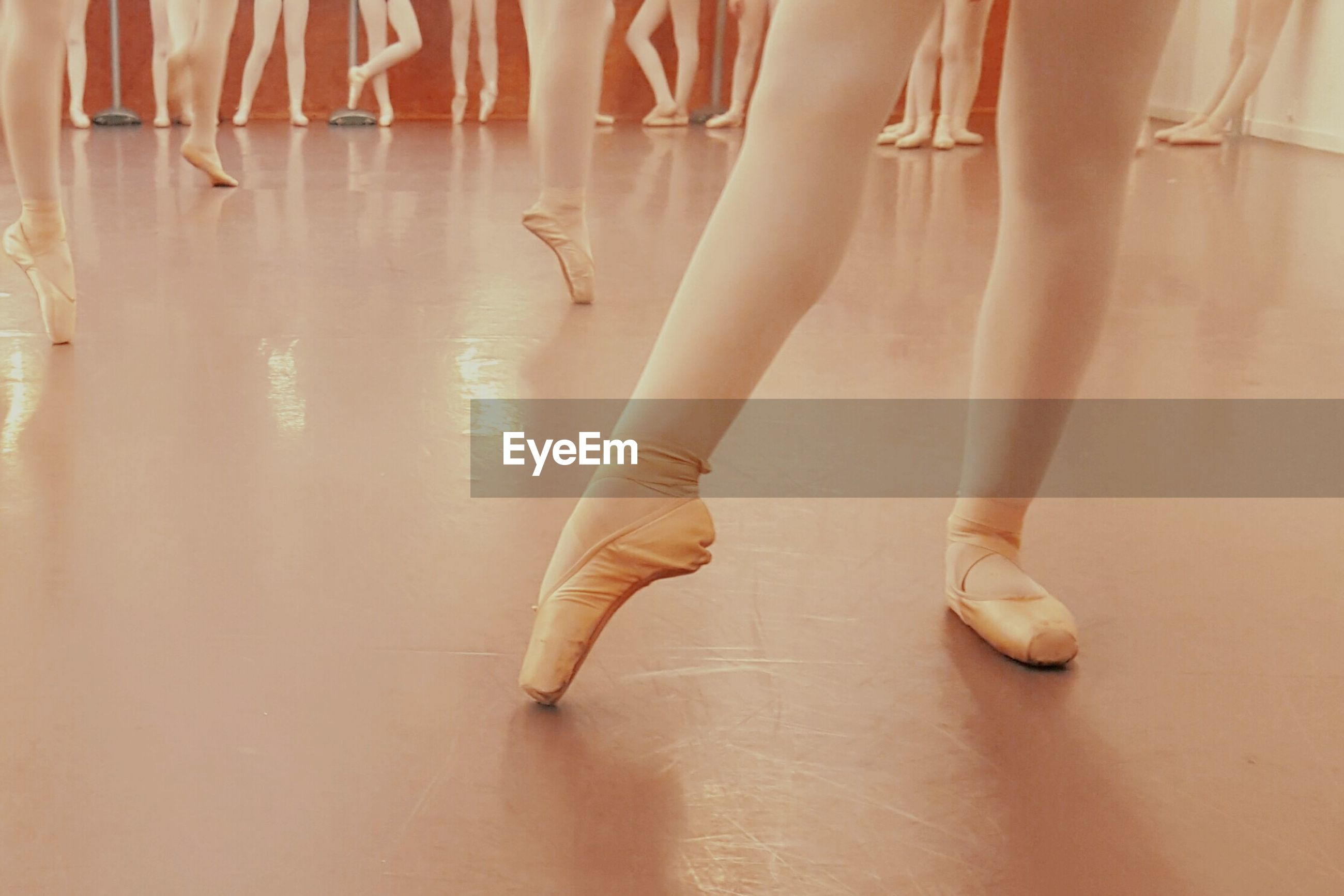 Low section of ballerinas practicing in dance studio