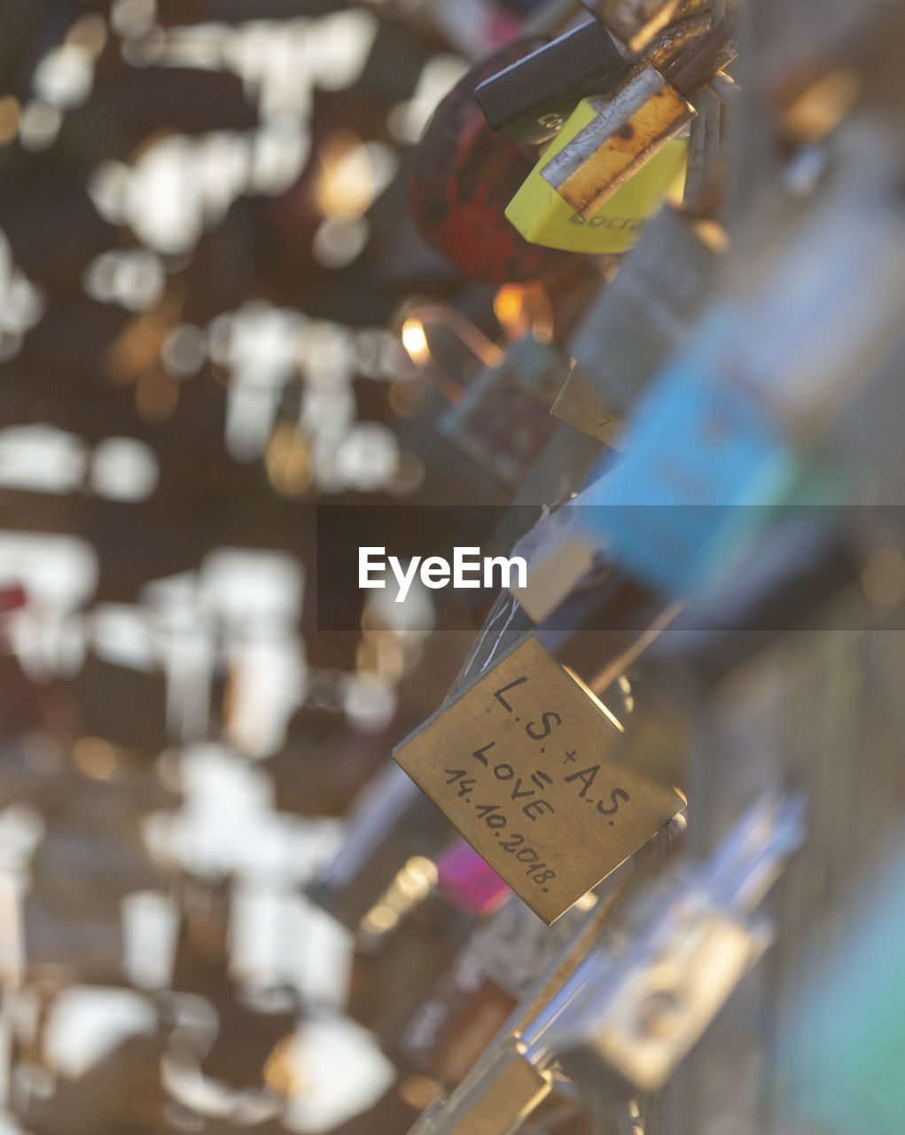 hanging, selective focus, communication, close-up, text, no people, security, protection, padlock, western script, day, safety, metal, love lock, outdoors, abundance, lock, positive emotion, label
