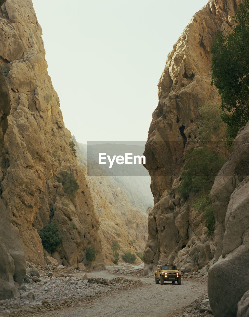 Vehicle on road amidst mountains