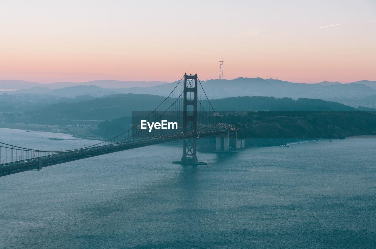 Golden Gate Bridge Over San Francisco Bay Against Clear Sky During Sunrise