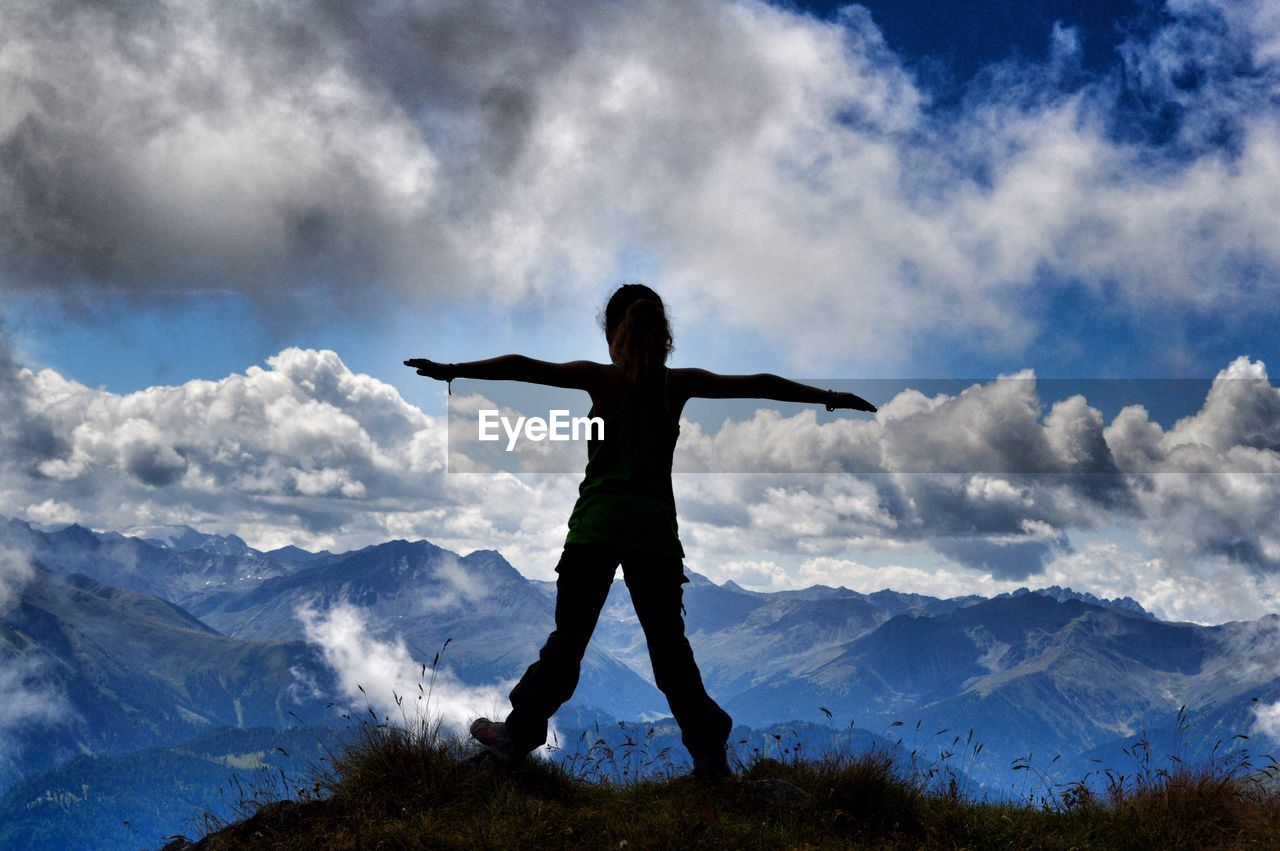 Silhouette Of Woman On Mountain