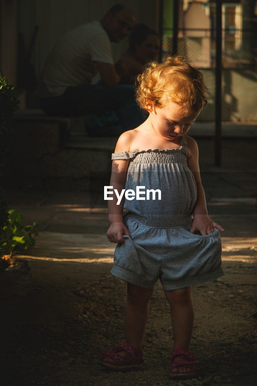 Full Length Of Cute Girl Standing In Yard