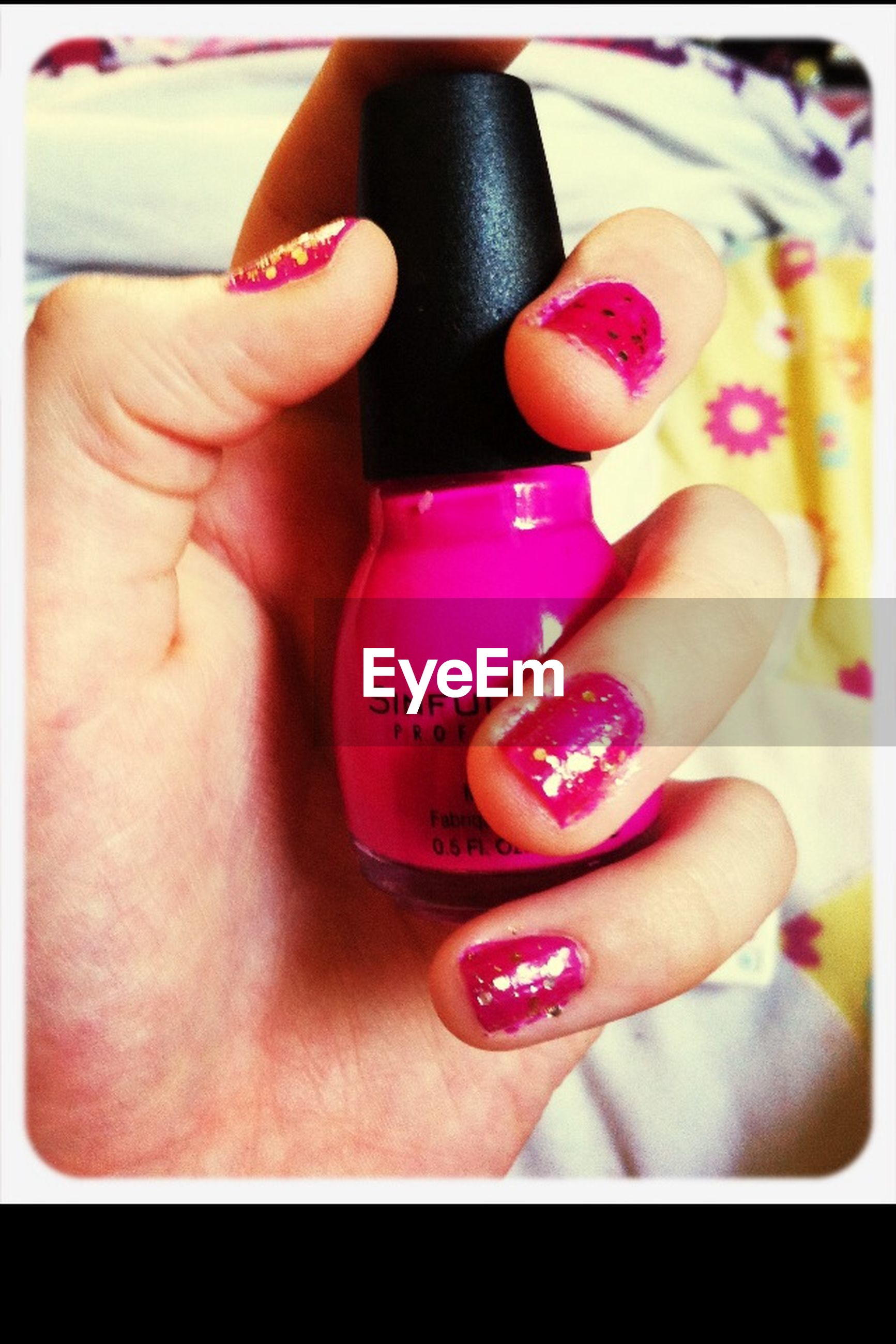 person, transfer print, indoors, auto post production filter, holding, part of, lifestyles, human finger, red, cropped, close-up, high angle view, leisure activity, nail polish, heart shape, personal perspective