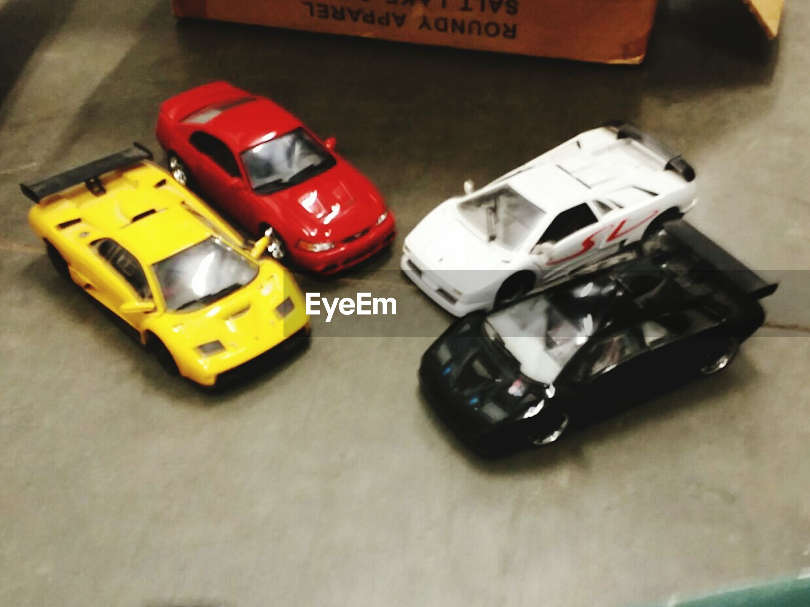 toy, transportation, toy car, car, high angle view, land vehicle, no people, indoors, day, close-up