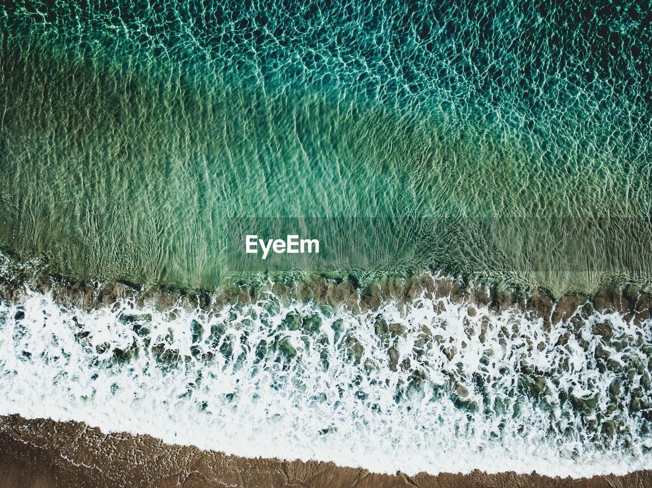 water, sea, aquatic sport, motion, surfing, sport, wave, day, nature, beauty in nature, land, beach, scenics - nature, power, splashing, power in nature, high angle view, outdoors, flowing water, breaking, turquoise colored