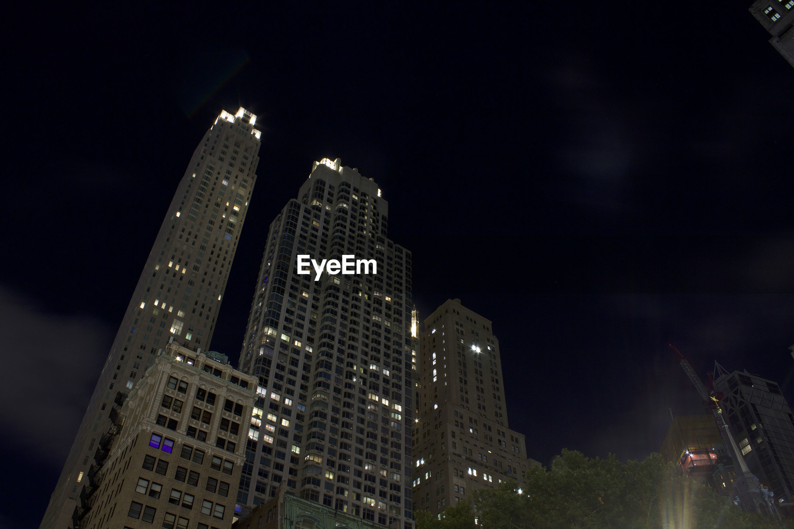 LOW ANGLE VIEW OF ILLUMINATED BUILDINGS AGAINST SKY