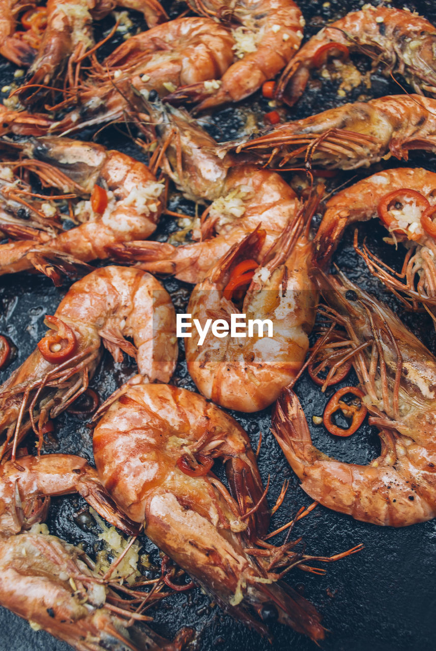 High Angle View Of Shrimps On Barbecue Grill