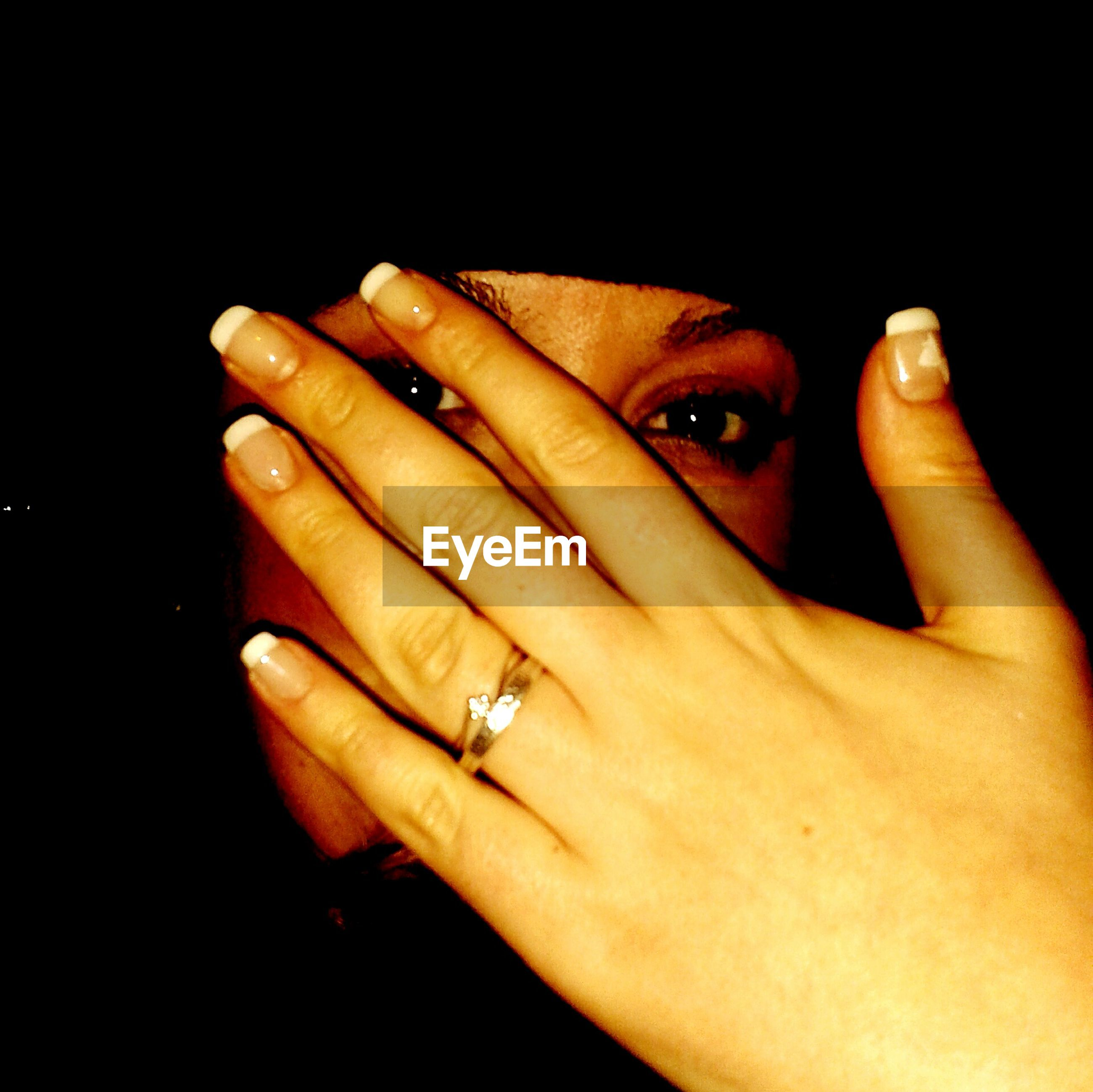 person, indoors, part of, holding, human finger, studio shot, lifestyles, close-up, cropped, black background, leisure activity, showing, men, unrecognizable person, ring, front view