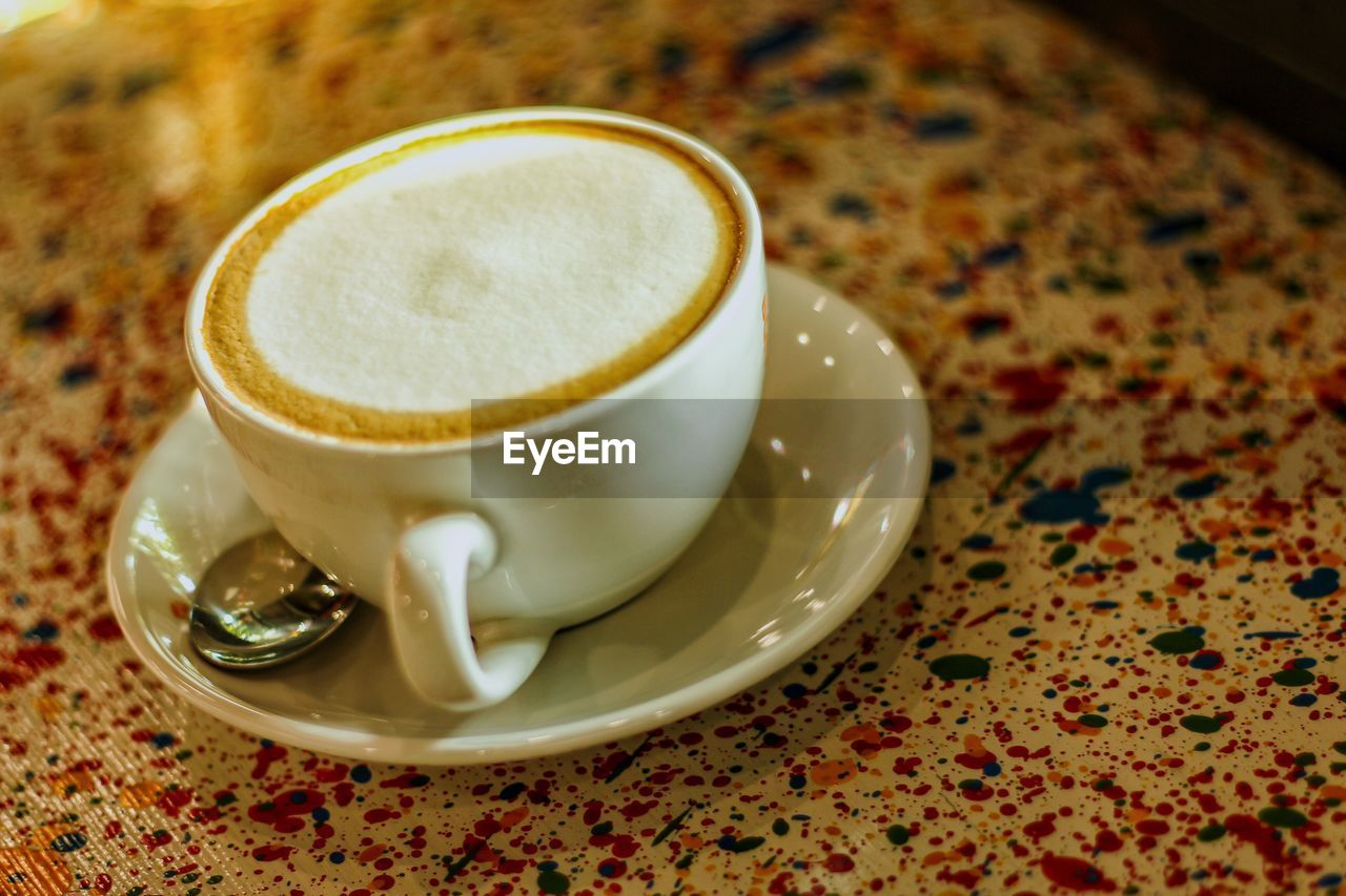 refreshment, coffee, food and drink, drink, coffee - drink, cup, coffee cup, mug, still life, saucer, table, indoors, crockery, close-up, no people, frothy drink, freshness, focus on foreground, kitchen utensil, high angle view, hot drink, temptation, froth, floral pattern, non-alcoholic beverage