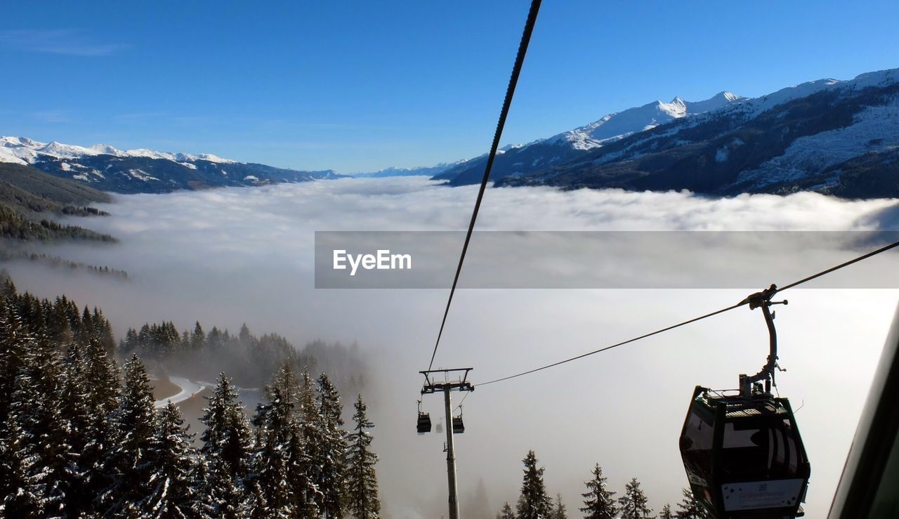 mountain, snow, sky, scenics - nature, cold temperature, beauty in nature, cable car, cable, winter, overhead cable car, nature, ski lift, mountain range, tranquil scene, day, tree, transportation, tranquility, snowcapped mountain, no people, outdoors, electricity