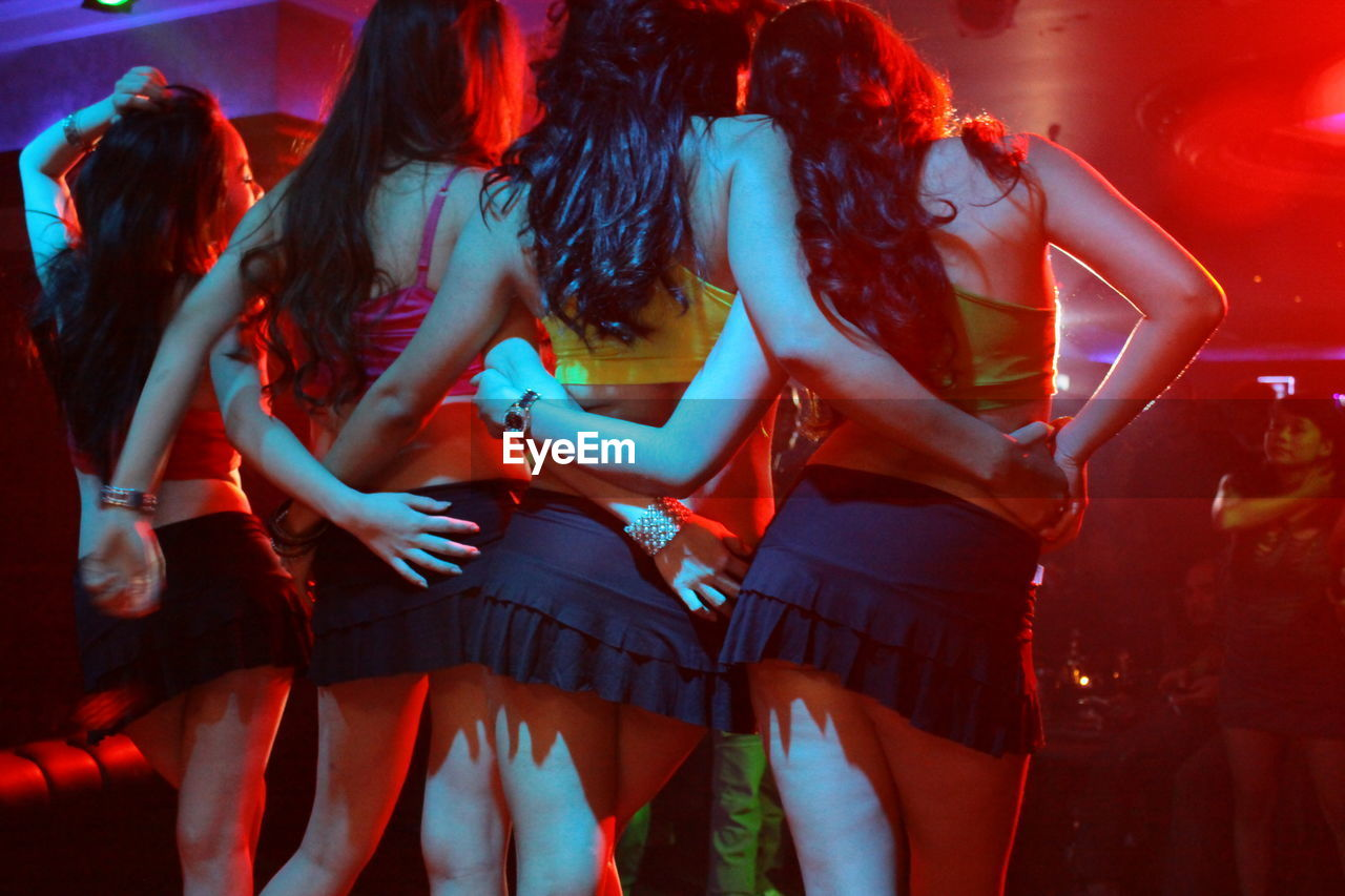 Rear view of women dancing at nightclub